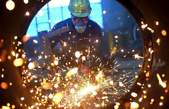 China's manufacturing PMI rises in September
